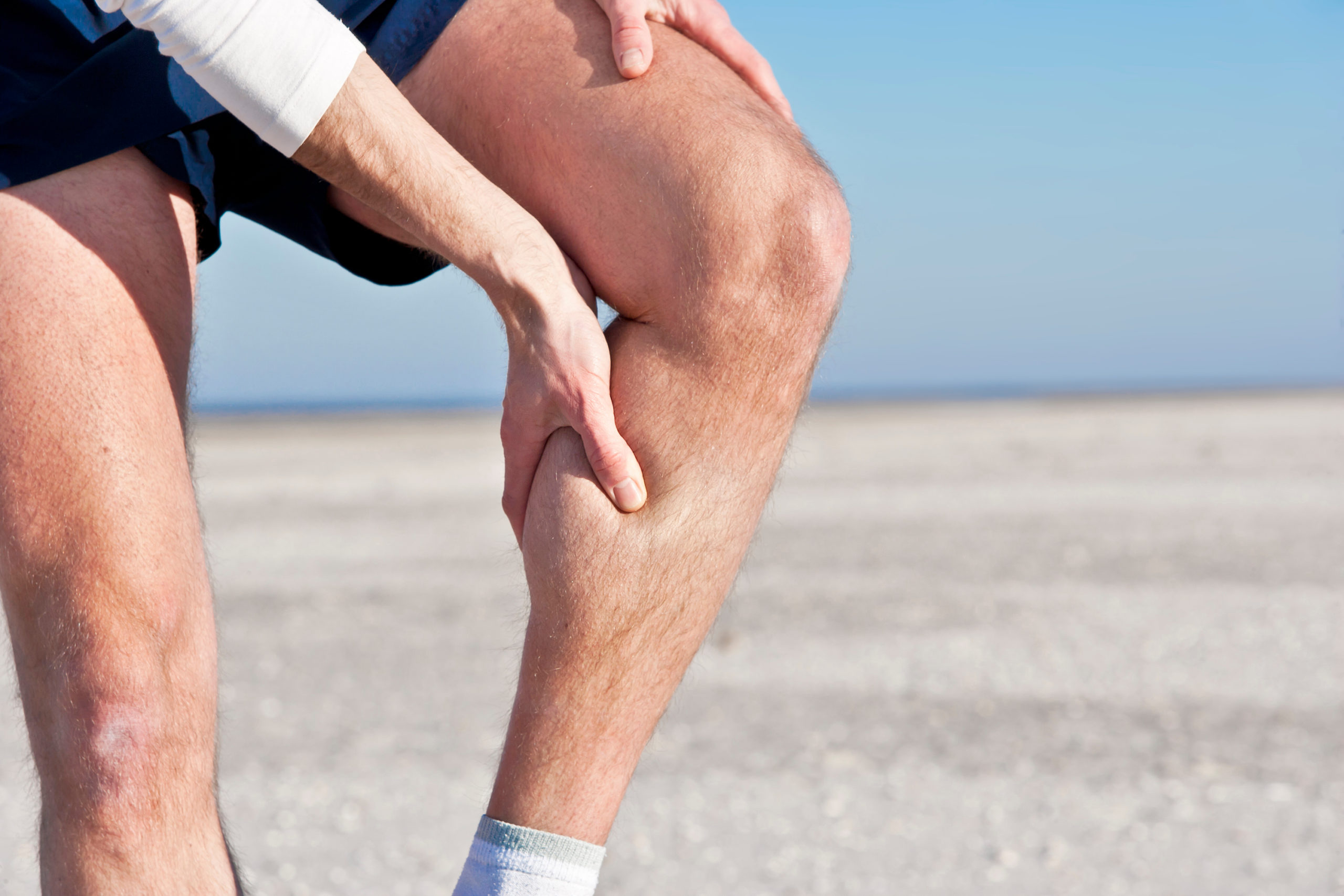 man with painful sore les form squatting